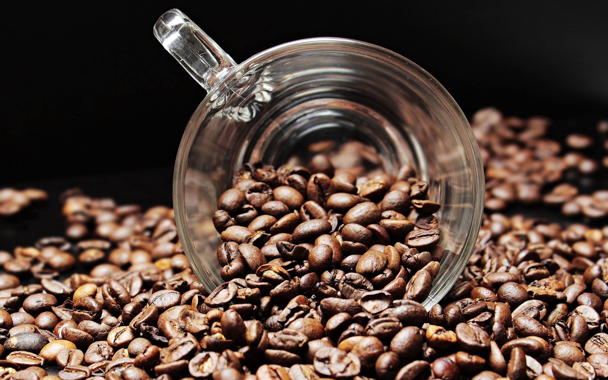 Coffee beans and glass cup