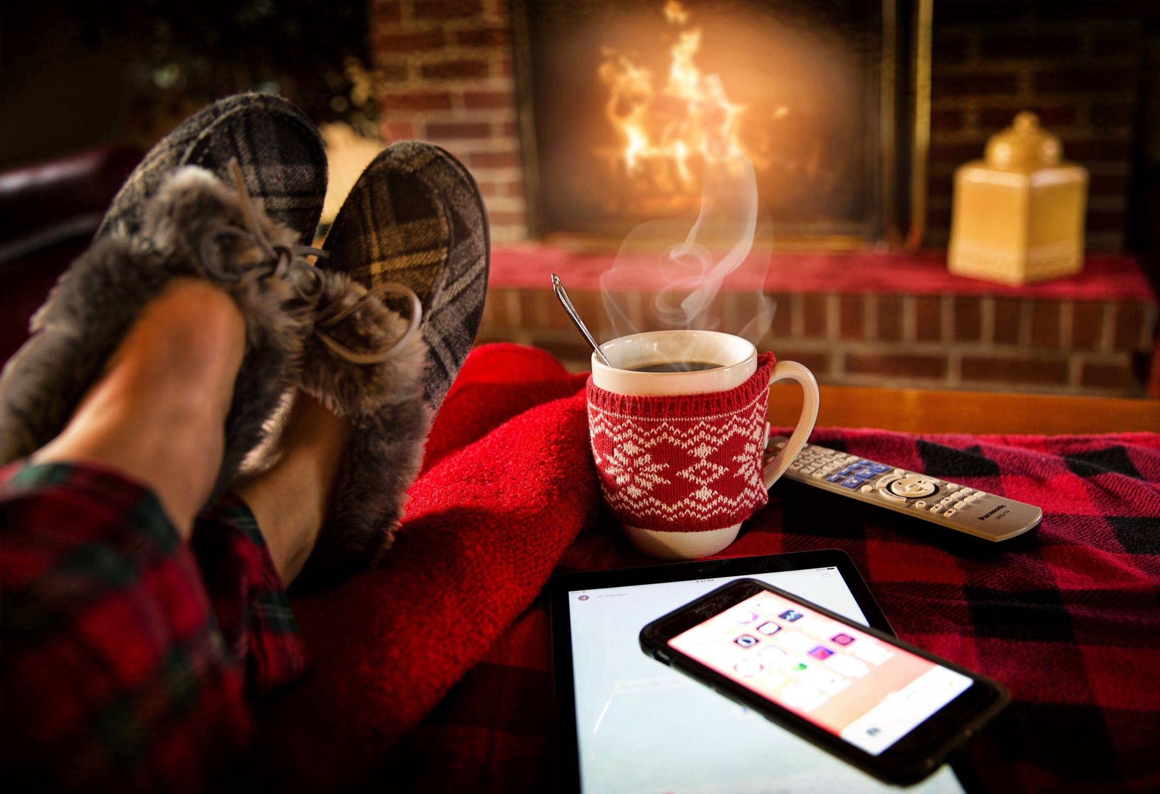 Mug of coffee in front of fire