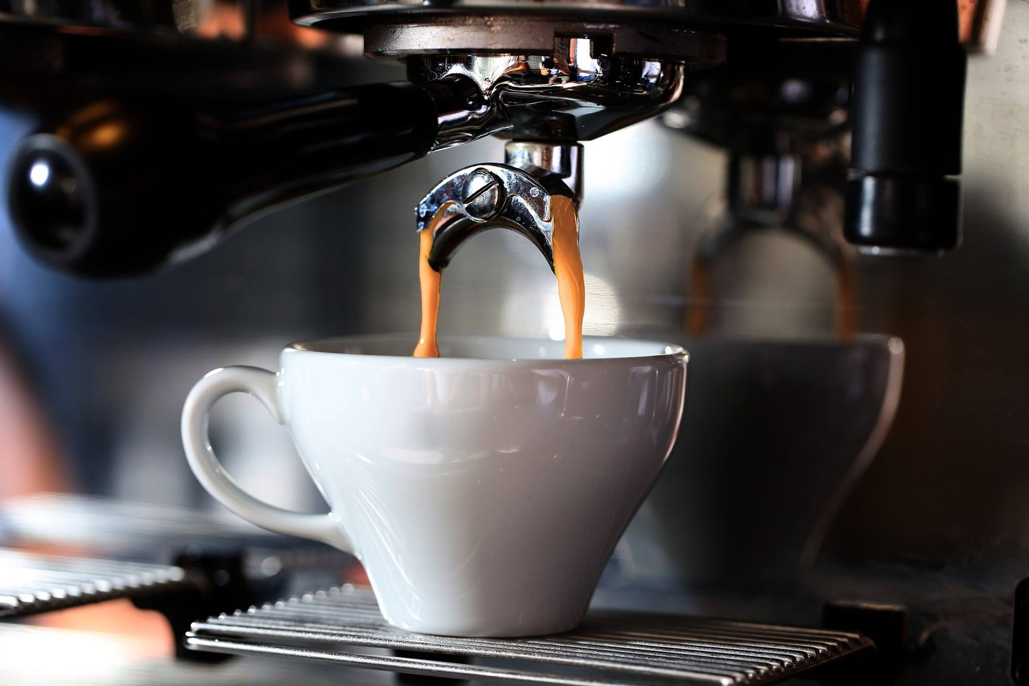 Coffee machine pouring a coffee