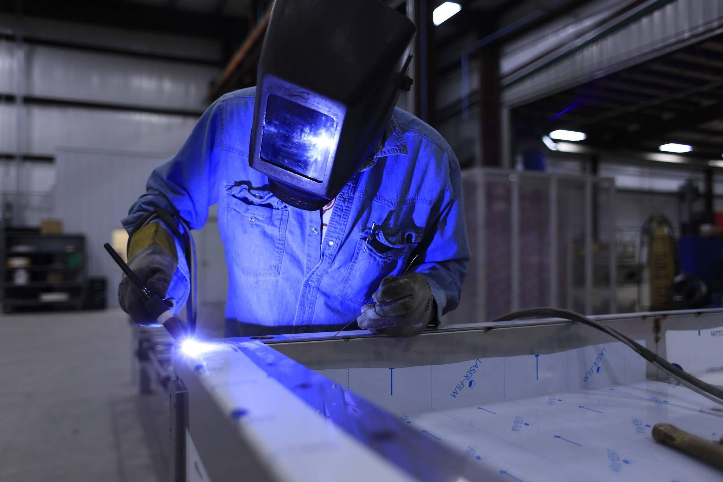 Worker factory welder welding
