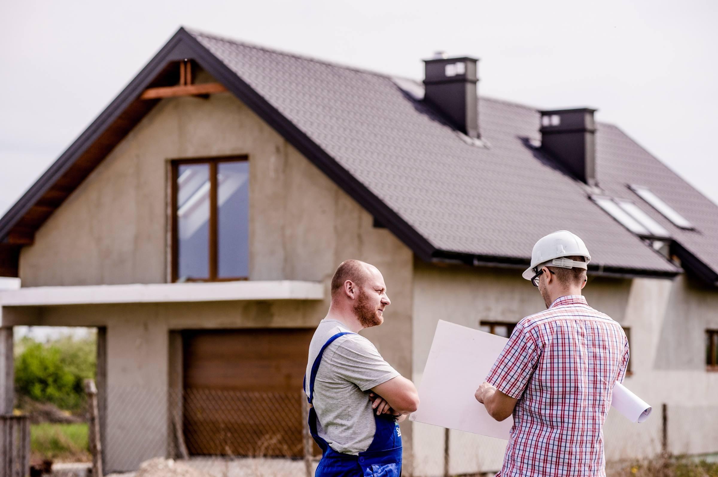 Workers builder architect plans blueprints house