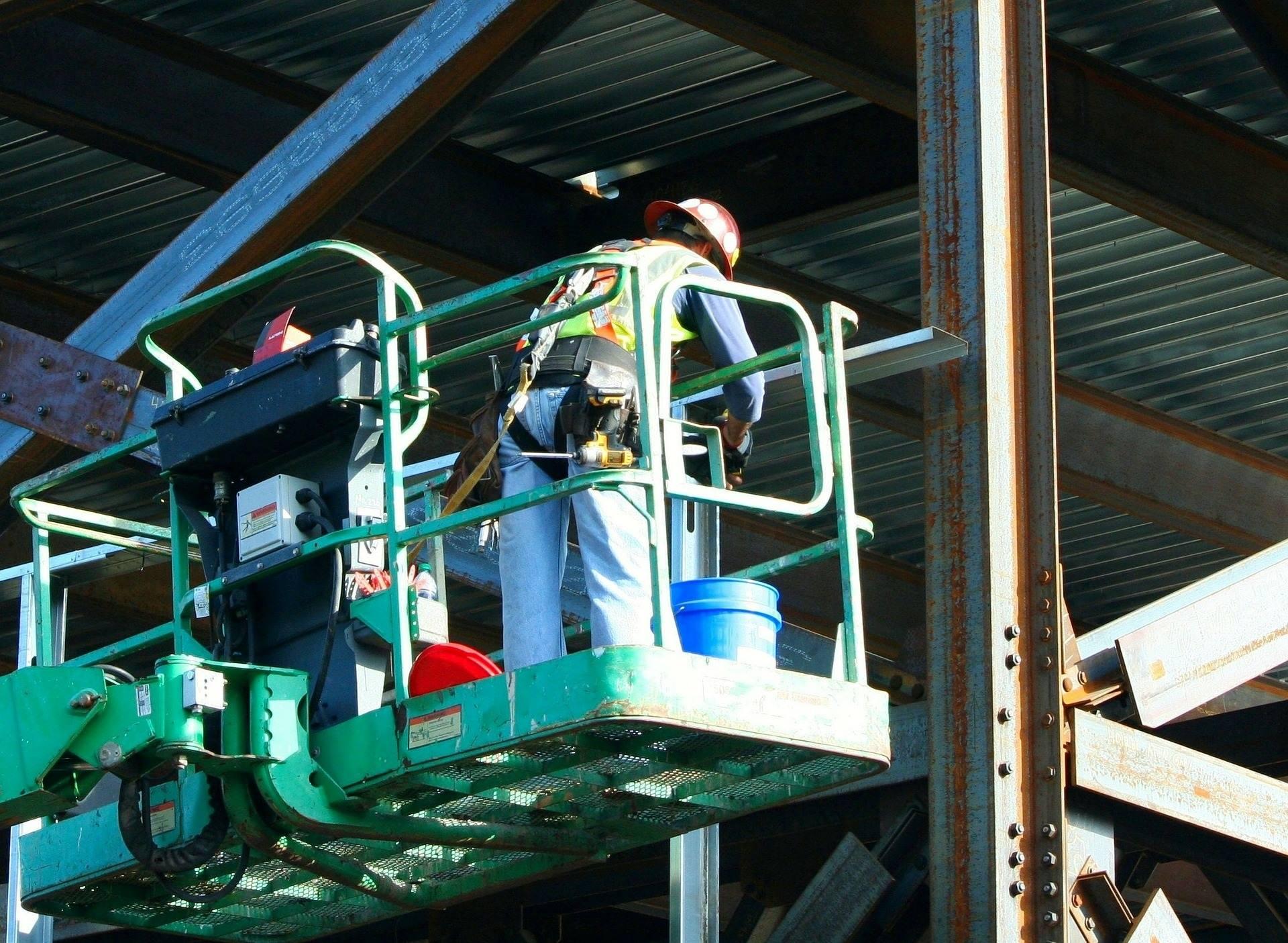Workers hoist industrial