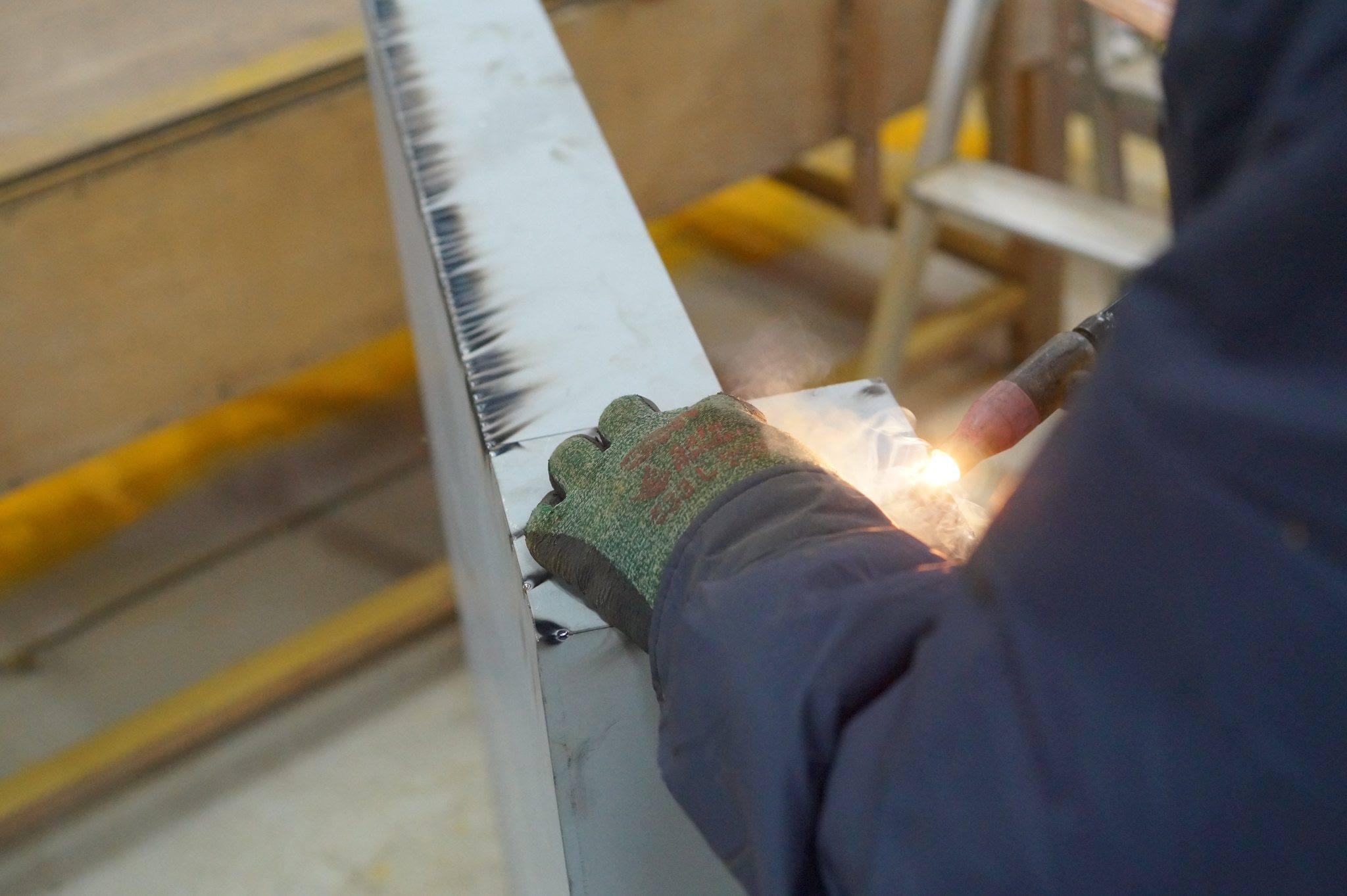 Worker welding steel industry