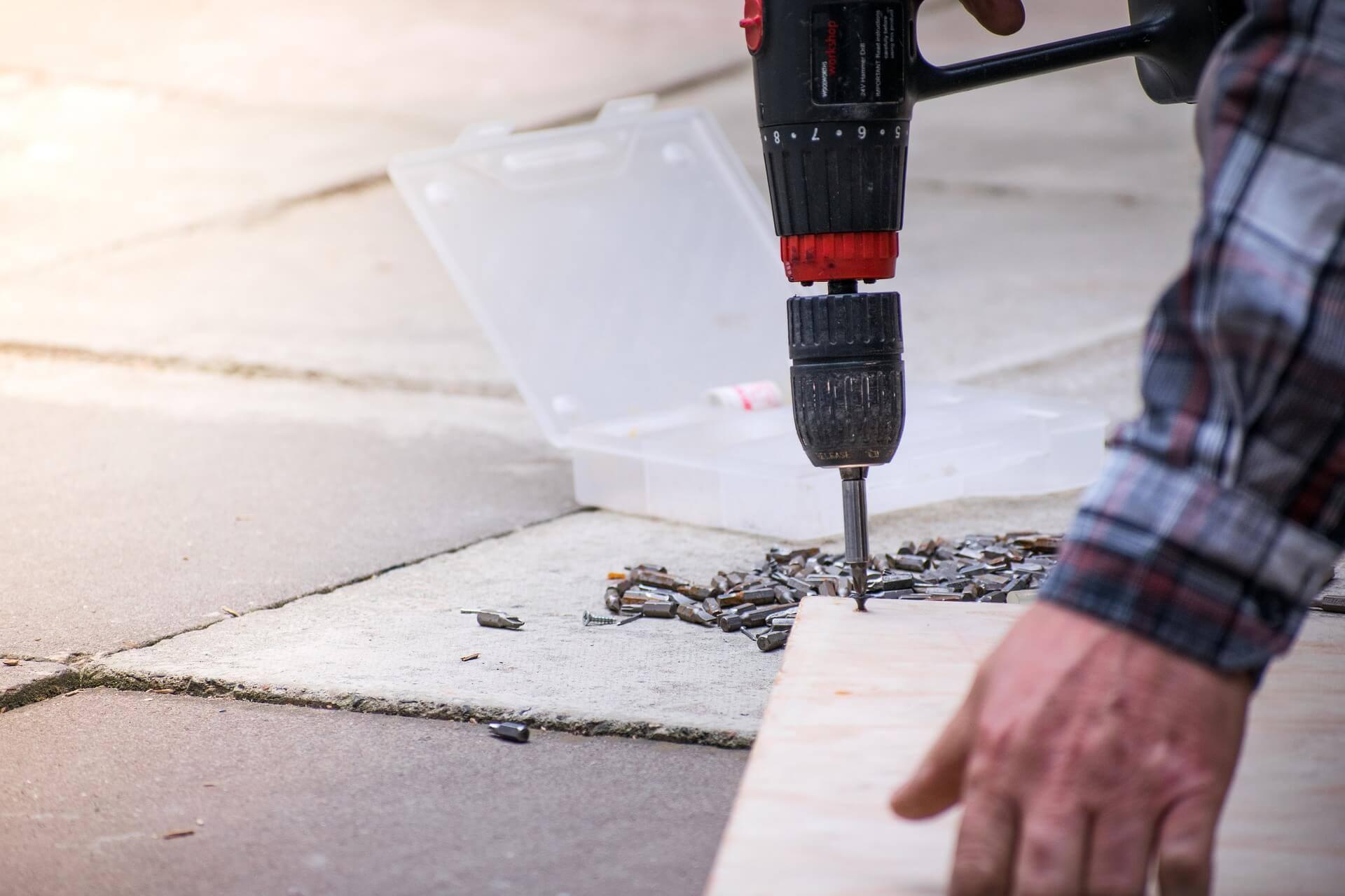 Worker drilling screwdriver