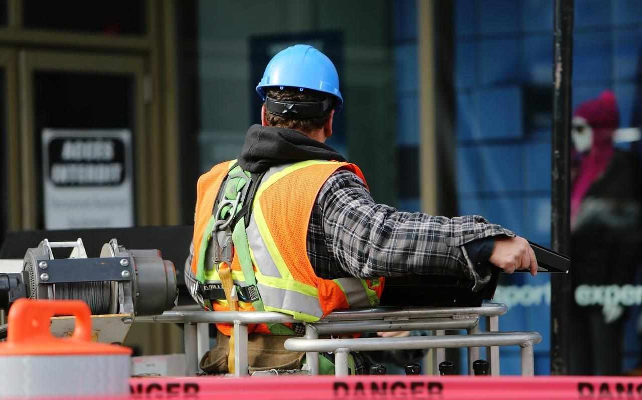 Worker cables man helmet