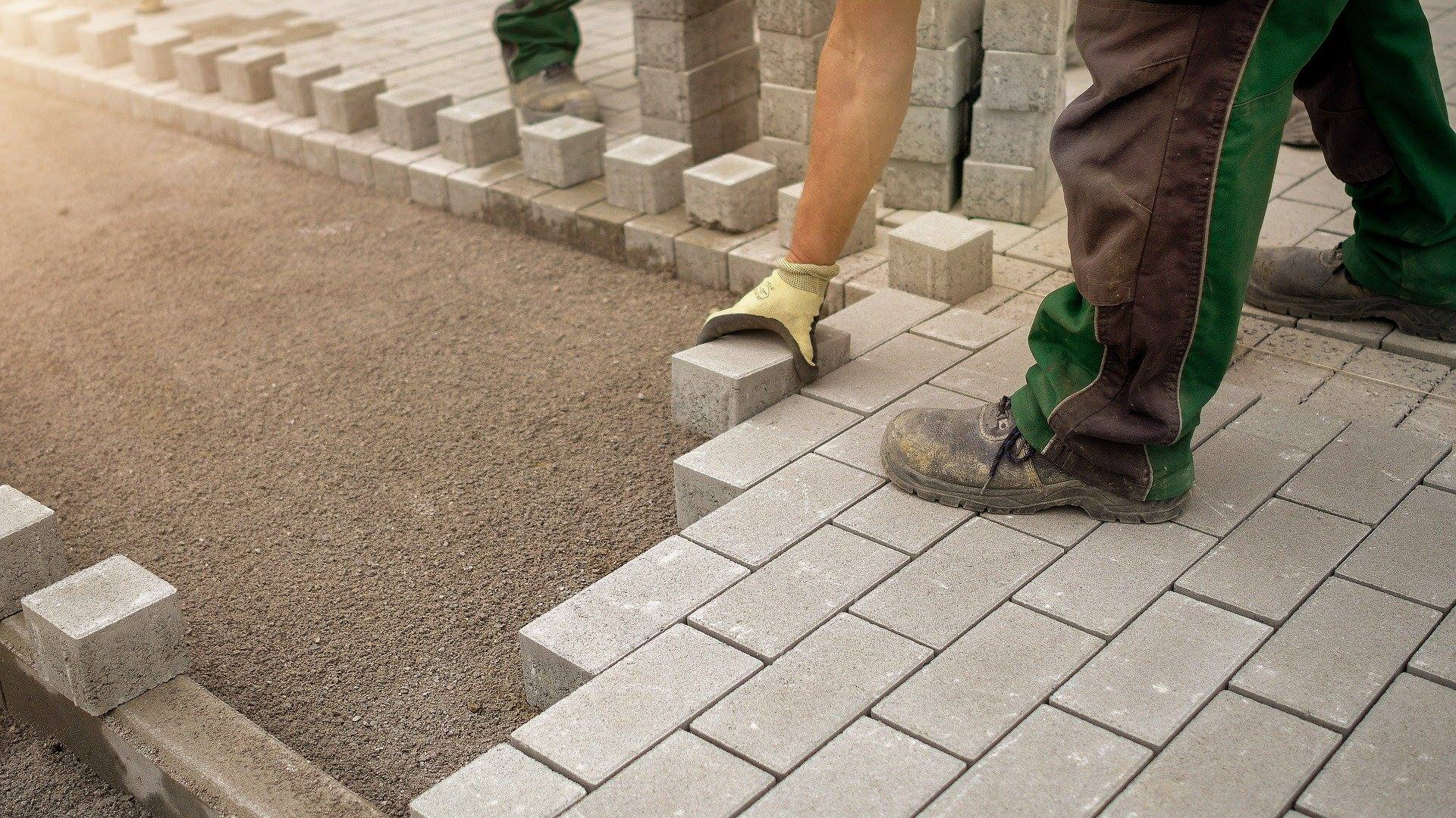 Worker paver sidewalk