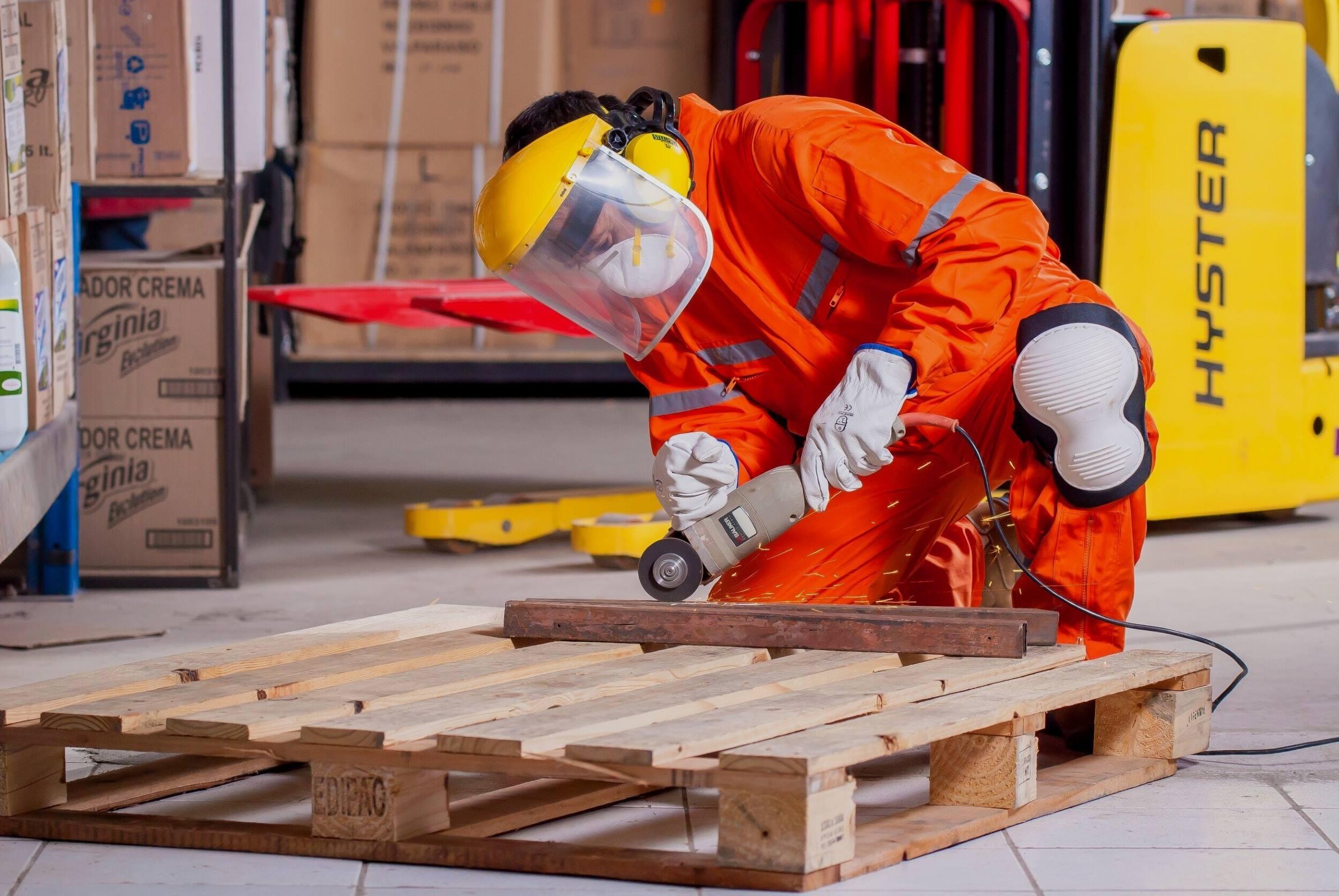 Worker grinding pallet