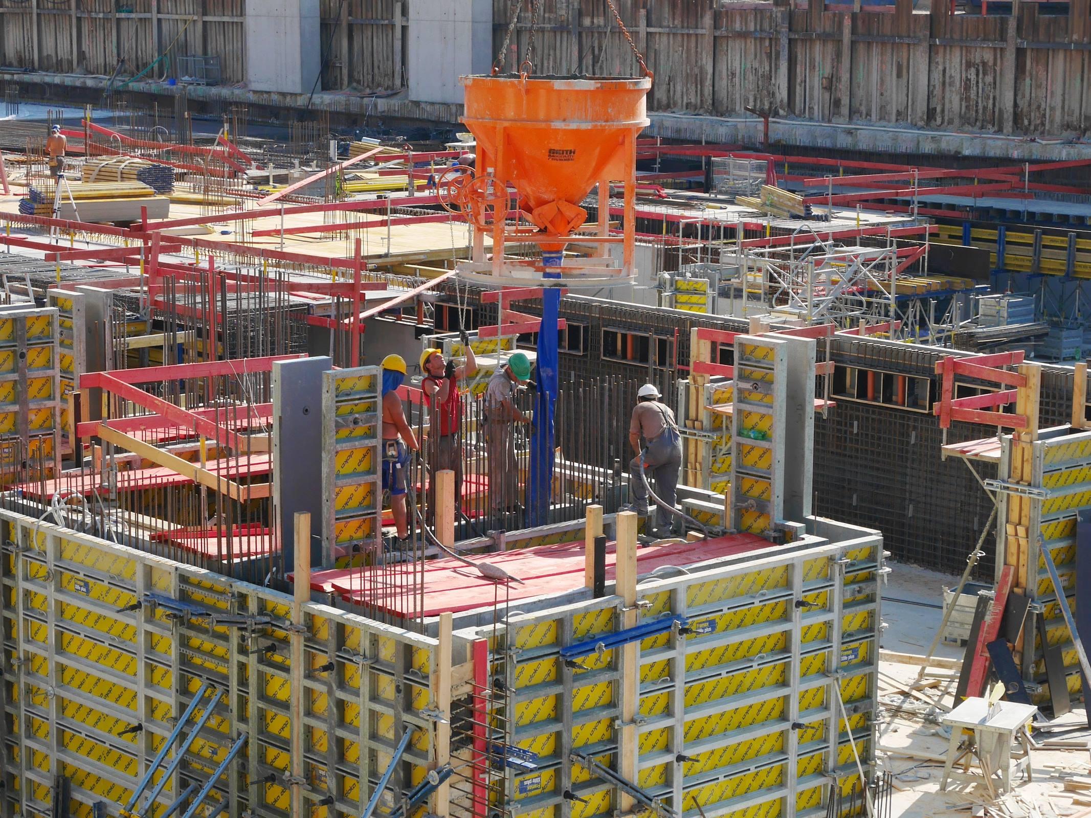 Workers building site construction concrete