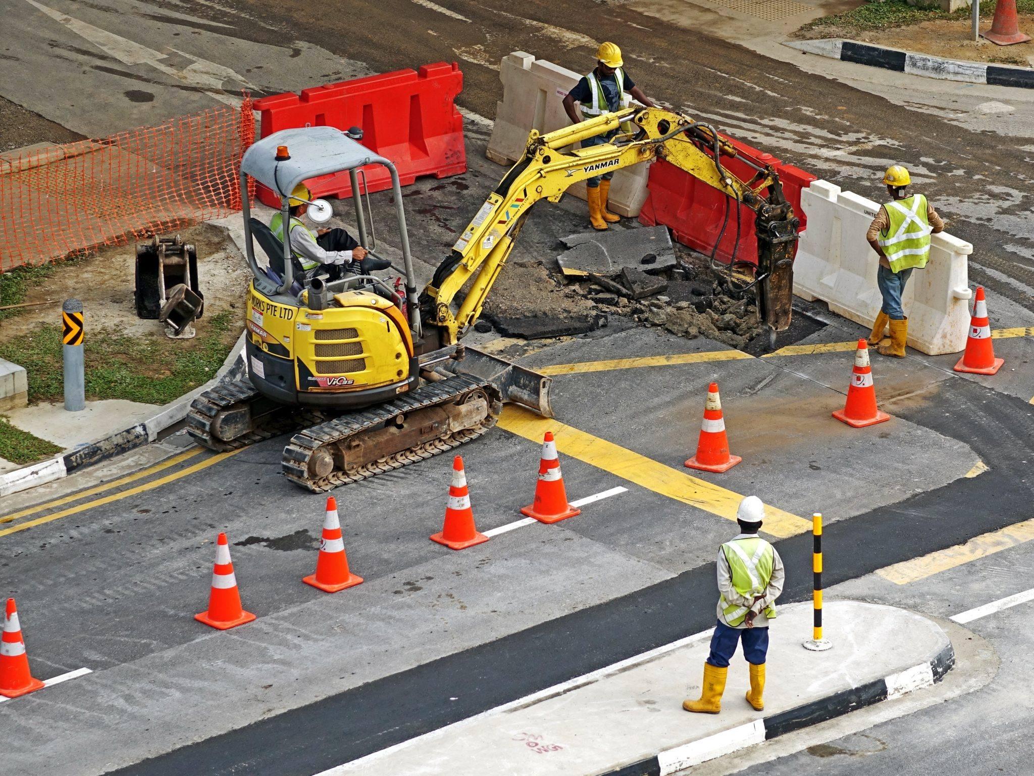 Roadworkers digger highway