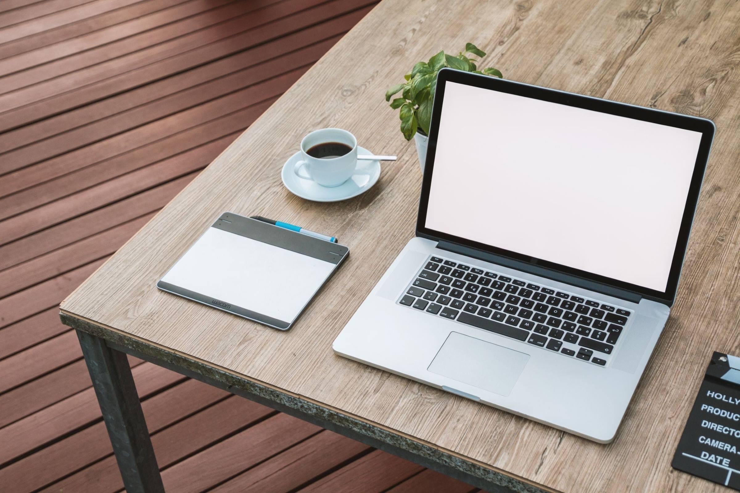 laptop notepad coffee plant clapper board