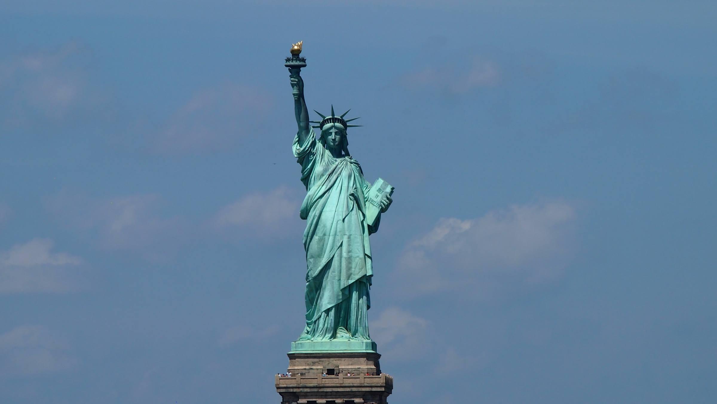 statue of liberty new york blue sky