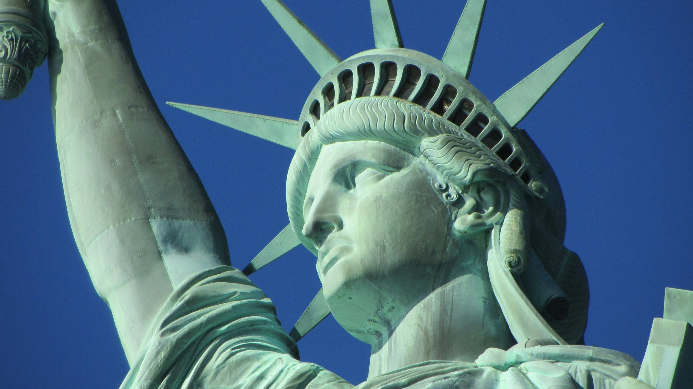 statue of liberty new york face arm