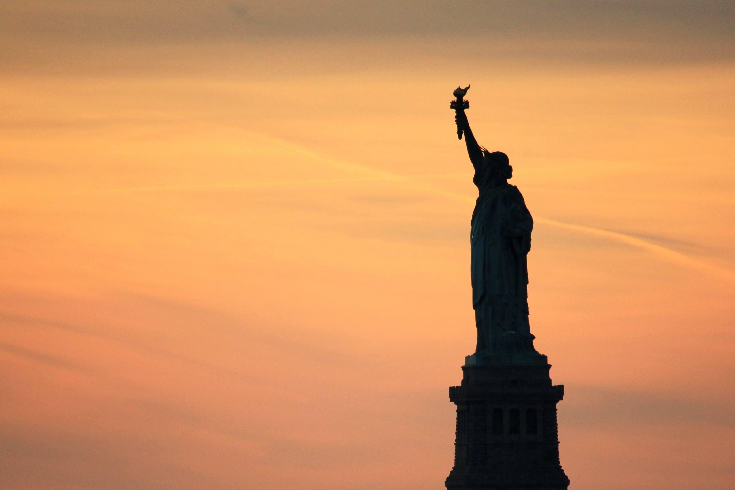 statue of liberty new york sunset silhouette