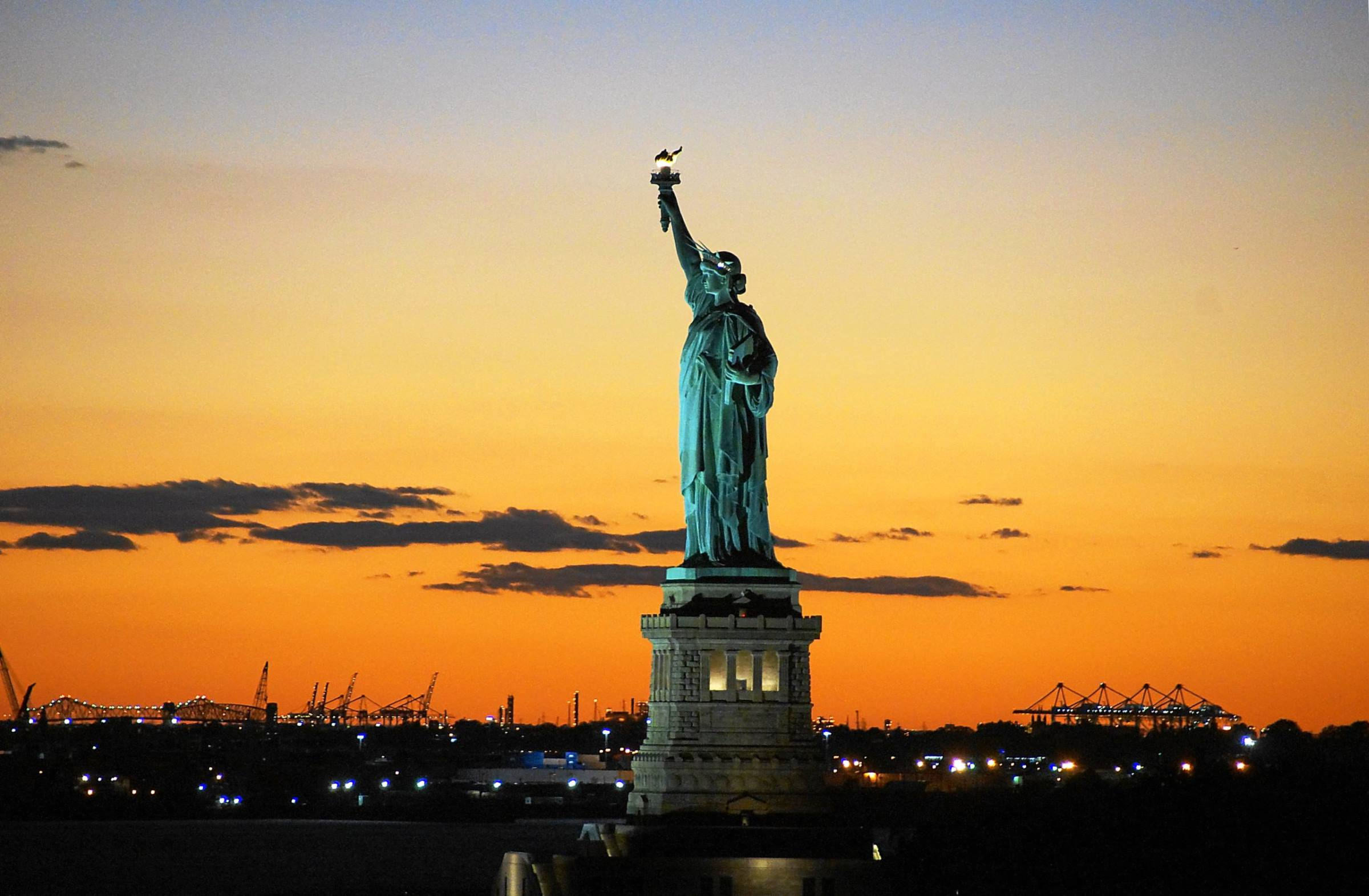 statue of liberty silhouette new york sunset