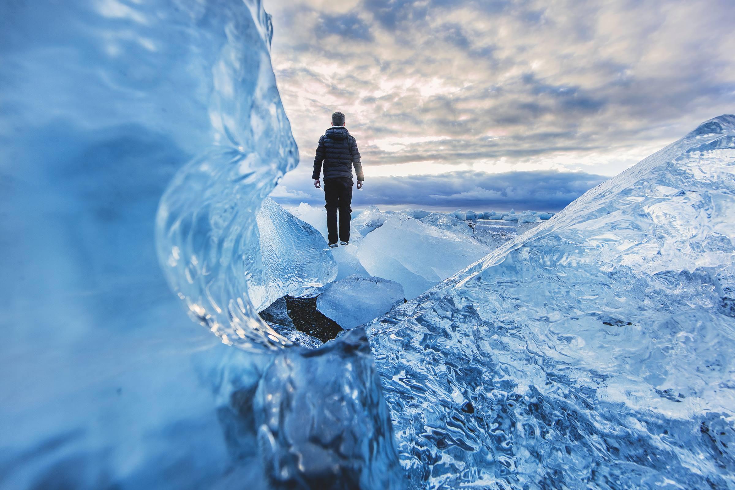 winter glacier man mountains snow