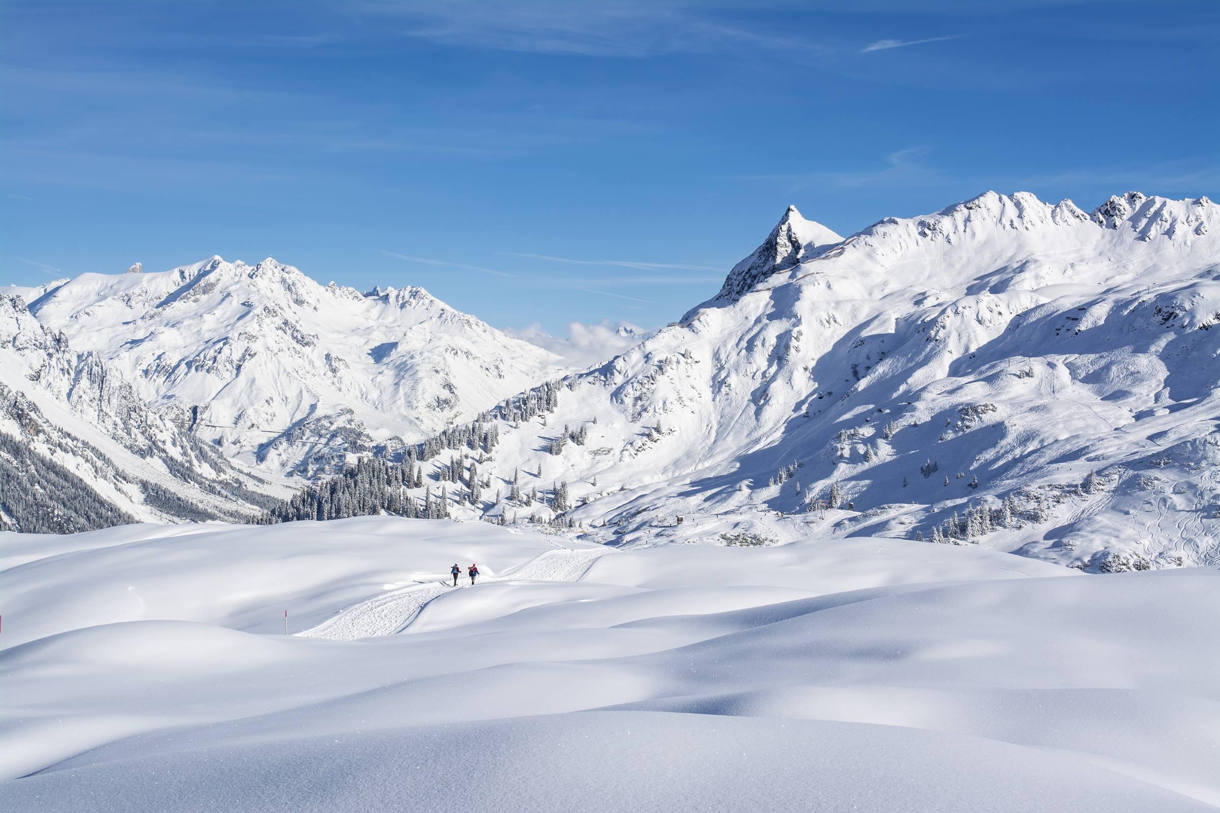 winter landscape snow mountains alps walkers