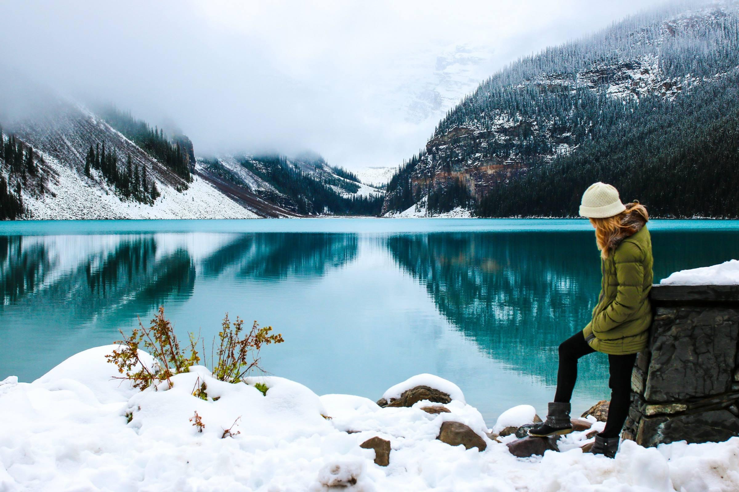 winter snow woman lake mountains