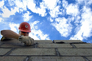Worker roofer shingles