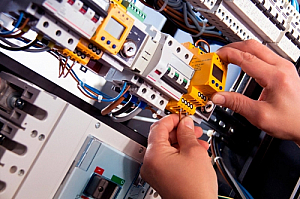 Electrician wiring a fuse board