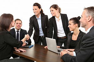 office meeting men women laptop table