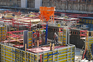 Workers building site construction concrete