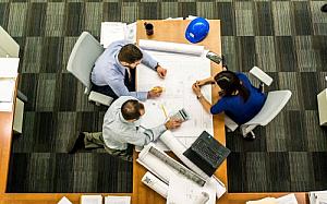 office meeting plans blueprints desk men woman