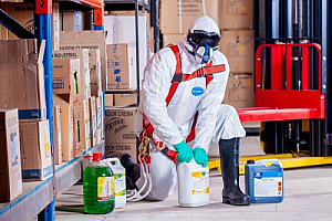 Worker chemicals spraying