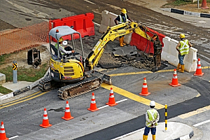 Roadworkers digger highway