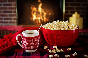 Mug of coffee and popcorn