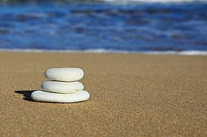 Stone balancing on a beach
