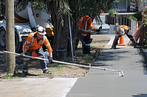 Workers laying concrete path