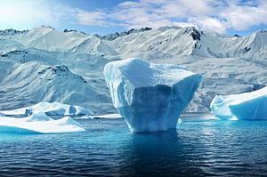 winter iceberg water snow mountains