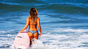 Young woman surfer
