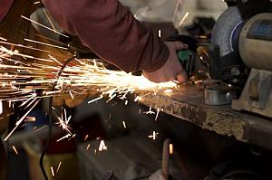 Worker grinder metal sparks