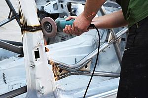 Metal worker grinding