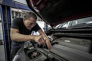 Auto mechanic repairing an engine